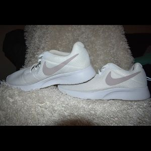 White Nike Tanjuns with Blush Swoosh